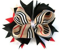 Girls Hair Bow, Burberry Stacked Boutique Hair Bow, OTT Boutique Hair Bow. $13.75, via Etsy.