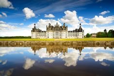 Chateau de Chambord royal medieval french castle and reflection. Loire Valley France Europe. Unesco heritage site.