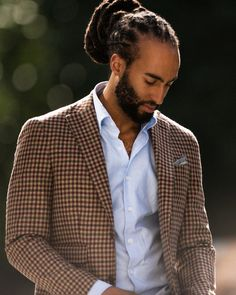 This man who is the definition of tall, dark, and handsome. | 23 Beard And Man Bun Combinations That Will Awaken You Sexually