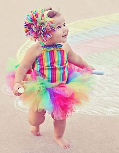 How adorable would the birthday girl be in this rainbow tutu outfit for her rainbow birthday party! 4theprincessboutique via Etsy.