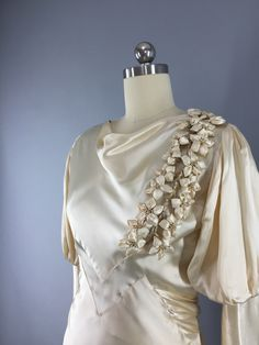 Originally worn in Light champagne bias cut rayon duchesse satin with cowl neckline and full leg omutton sleeves. Attached satin half-belt in back with sil 1930s Fashion, Art Deco Fashion, Vintage Fashion, Vintage Bridal, Vintage Weddings, Vintage Dresses, Vintage Outfits, 1930s Wedding, Antique Clothing