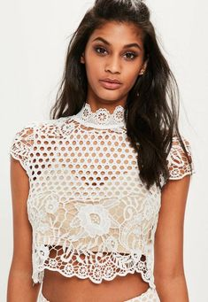 Look lavish in lace. This premium top features a fresh white hue, full lace overlay, high neck and button detail at the back. It's a serious weekend show-stopper!