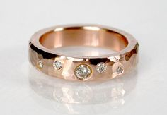 4mm's of hammered 14k pink gold with scattered diamonds.  One diamond from each grandmother.....and then a little extra :)