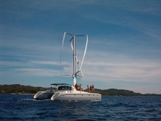 Windmill or Wind Turbine- powered boats: how many are out there, and are they viable?-vertical_windmill_catamaran.jpg