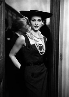 26th February 1955: A grey pinstripe dress, worn with strings of pink beads and a wide-brimmed hat. Original Publication: Picture Post - 7551 - An American's Eye View Of London Fashion - pub. 1955 (Photo by Thurston Hopkins/Picture Post/Getty Images). From dovima_is_devine_II, via Flickr. #fashion #clothes