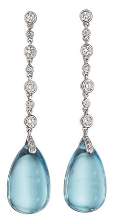 Classic blue topaz and diamond earrings. Such beauties! (Via Phillips.)