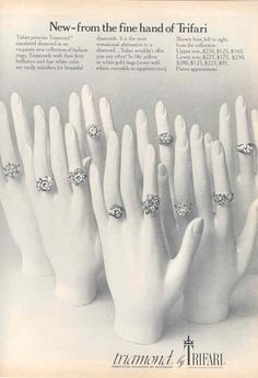 1972 - TRIFARI - ADS - New-from the fine hand of Trifari - Trifari presents Triamond ® simulated diamond in an exquisite new collection of fashion rings. Triamonds with their fiery brilliance and fine white color are easily mistaken fon beautiful diamonds. It is the most sensational alternative to a diamond ... Trifari wouldn't offer you any other! In 14k yellow or white gold rings (some with rubies, emeralds or sapphires too). Vogue Magazine 1972