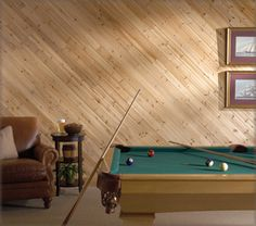 picture of a wall with wood paneling diagonal | Pacific Knotty Cedar Wall Planking diagonal application