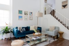 In a mostly all-white living room, the plush velvet sofa is definitely the star of the show.