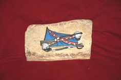 Hand Painted Confederate Civil War Tribute on Mississippi Petrified Wood      #artsandcrafts #petrifiedwood #fossil #rock #minerals #handpainted #originalart #nature #decor #naturedecor #crafts #art #civilwar #confederate #battle #saber #rifle #gun