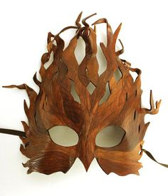 Tree mask out of leather.  Wow that is awesome!  Etsy