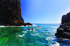Kayaking  on the ocean... one of the many activities you can enjoy on a Hawaii honeymoon.