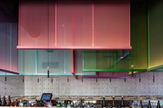 Pitsou Kedem designs colourful screens based on Japanese kites for Tel Aviv bistro