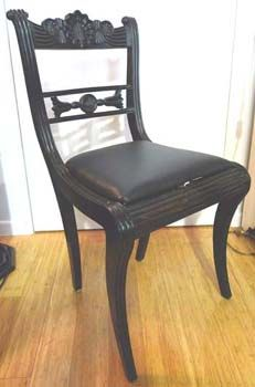 A Pair of Anglo Indian Ebony chairs.