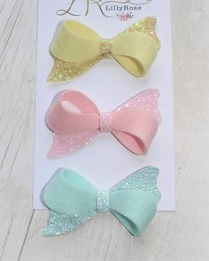 A set of pretty Bows in 100% wool felt and glitter that will be added to my Spring collection xx