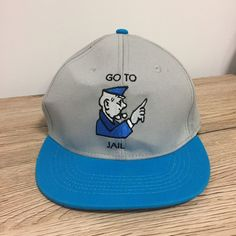 0189c64ab53 Go To Jail Monopoly Official Hasbro Grey Blue Embroidered Snapback Cap Hat