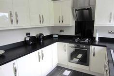 An Innova Livorna High Gloss Cream Kitchen - http://www.diy-kitchens.com/kitchens/livorna-cream/details/