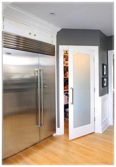 Striking Frosted Glass Door For Pantry With Polished Square Stainless Steel Tubing For Door Pull Handle On Small Walk In Pantry Organizer Systems from Kitchen Pantry Ideas