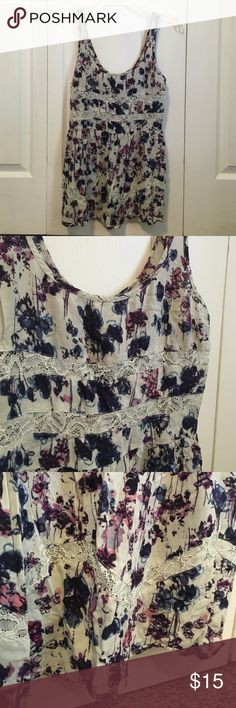 Cute floral lace tank Never worn! No damage! There are two strips of lace on the top and bottom. It says small but I'm a medium and can fit into it. Let me know if you have any questions and feel free to make an offer Aeropostale Tops Tank Tops