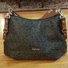 Calvin Klein Handbag Brown Calvin Klein Handbag new condition. Measures approximately 15 in. wide and 11 in. Tall not including the handles. Calvin Klein Bags Satchels