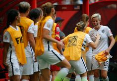 Megan Rapinoe greeted by teammaes after she exits the match in the second half against Japan in the FIFA Women's World Cup Canada 2015 Final at BC Place Stadium on July 5, 2015 in Vancouver, Canada.