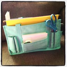 i use the Keep-It Caddy for a quick cropping bag.  It fits my old fiskars trimmer, timeless beauty bag, and plenty of smaller goodies and 6x6 paper pads