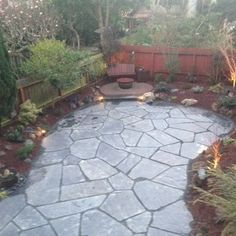 slate patio with water feature and firepit | Yelp