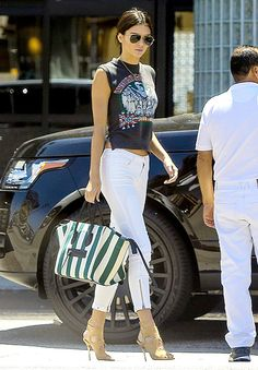Kendall Jenner worked a rocker crop top and white skinny jeans while leaving a gym with Justin Bieber on May 10.