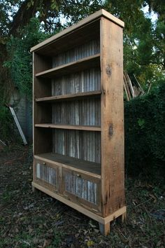 Galvanized tin on the back of the bookcase, and in the doors.....love this!