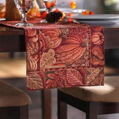 Looking for a holiday table runner? This one is gorgeous with its rich autumn reds and pumpkin print! #kirklands #harvest