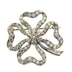 Cartier Diamond Clover Pin | From a unique collection of vintage brooches at https://www.1stdibs.com/jewelry/brooches/brooches/