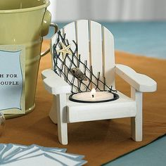 These beautiful wooden deck chair candle holders are perfect for a beach themed or outdoor wedding. The candle holder are not only a great centerpeice idea but they can also serve as favors or place card holders