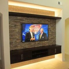 Inspiration photo of sorts for Jacq - do something not so contemporary and do cabinets to the floor but the accented back wall and uplighting is a good idea? TV niche TV wall before & after