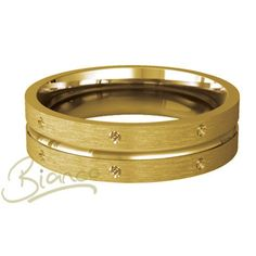 """An exceptionally pretty, ladies, flat court shaped, wedding band design with a satin finish with eight diamond cut features This design can be ordered in various precious metals, including 9ct or 18ct white, yellow or rose gold, platinum and palladium. This lovely ring, named """"Emitie"""" is from the beautifully crafted Bianco collection of Baird & Co."""