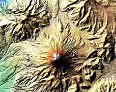 """This image was taken on Feb. 19, 2000, by Space Shuttle Endeavor as it mapped elevations on the Earth's surface. Mount Cotopaxi is prolific in its eruptions, having done so as many as 50 times since 1738. Of the image, """"blue and green correspond to the lowest elevations in the image, while beige, orange, red, and white represent increasing elevations,"""" writes NASA. Located in the Andes mountain chain, Cotopaxi is known as the world's highest continuously active volcano."""