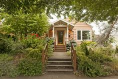 Absolutely oozing with charm, this Mt. Tabor cutie is only 2 blocks from the park and just up the street from happening Hawthorne! Lush, drought resistant gardens surround stone pathways and patios. Light, bright and cozy living room with gas fireplace, tastefully remodeled kitchen, and all new windows. Attached garage with fantastic shop plus tons of potential in basement with tall ceilings and 2nd fireplace.