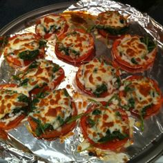 Marinate sliced tomatoes witih balsamic vinegar for 4-6 hours. Bake at 350 for about 7 minutes or a little tender. Meanwhile, sauté spinach and garlic with a dash of salt and lemon juice. Put spinach on top of tomatoes and sprinkle with low fat cheese of your choice (I chose Italian blend) and broil til cheese is golden!