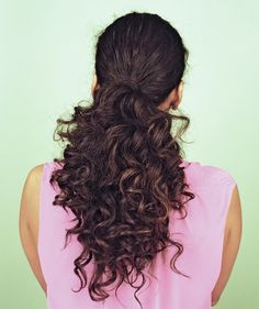 New hairstyles without a trip to the salon...   Curly dark brown ponytail, back of head view