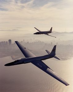 Two Lockheed U-2s fly over a foggy and mysterious... - You like airplanes, too?