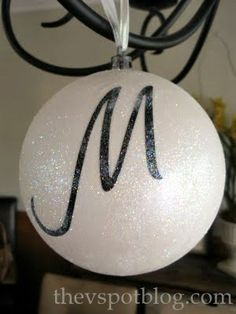 Take horrible, plastic, over-sized ornaments from the Dollar Store...spray paint white...Water down a little ModPodge in a shallow dish, float cut letter a moment or two.  Makes cardstock more pliable.  Place it on ornament, tap it down with finger. Once dried, put a coat of ModPodge (non-dilluted) over the whole thing and sprinkled it with glitter...Do several that make up words, then use  as embellishments on Christmas gifts for people who have those initials....
