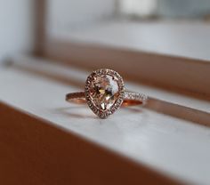 1.6ct Peach champagne tear drop sapphire 14k rose gold diamond ring. $1,850.00, via Etsy. BEAUTY!
