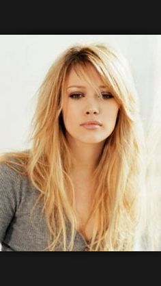 The go to style....medium layers side swept bangs.