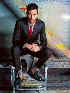 wow the red tie with the green snake skin shoes with no socks... Grey suit, plaid shirt, watch, hair and color make this a great menswear photo.