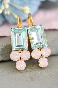 Aquamarine Earrings,Aquamarine Rose Quartz Earrings,Swarovski Pink Aqua Drop Earrings,Bridal Earrings,Bridesmaids Earrings, Gift For Her Dazzling Lever Back Crystal earrings feature a Step cut crystal with petite crystals set on a secure prong settings. The perfect shade for cocktail parties or to add a touch of color to your wedding ensemble Petite Delights is an Official SWAROVSKI® Branding Partner Our brand is legally licensed & authorized By Swarovski Company for high quality manufac...