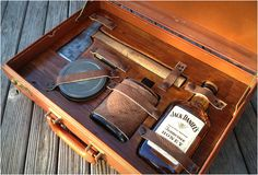 Survival Kit for Gentleman - The kit features everything you would need in an emergency including a flask, whiskey, hatchet, matches, and a handful of other goods packed into a vintage briefcase. cool idea for groomsmen gifts Jack Daniels, Art Of Manliness, Apocalypse Survival, Zombie Apocalypse, Man Up, Groomsman Gifts, Groom Gifts, Groomsmen Gifts Unique, Whisky