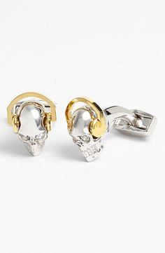 Skulls wearing gold headphones as cuff links. He can't really get much cooler.