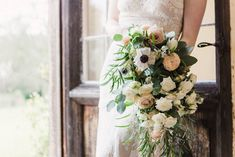 A beautiful arrangement of neutral and peachy coloured flowers with tonnes of greenery and foliage is always a recipe for perfection and that's perfectly shown in this wedding bouquet. The variation of leaf used gives it a more natural and earthy feel while the flowers keep it sophisticated and understated.