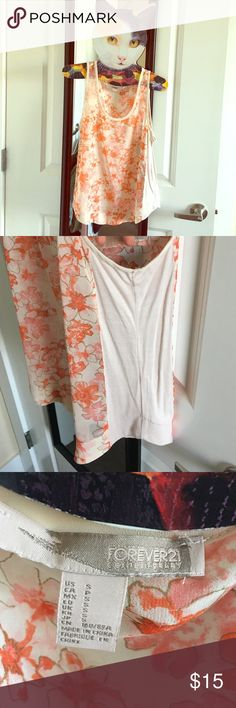 Cream sheer tank top with orange and pink flowers Forever 21 cream tank top. Sheer and covered in flowers both pink and orange. Has a stretch of cream fabric on the sides as well. Forever 21 Tops Tank Tops
