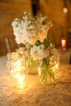 mason jars with WITH MIX OF FLOWERS & CANDLES  on burlap