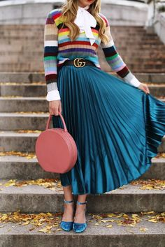 The Colorful Striped Sweater with teal pleated skirt and velvet shoes!